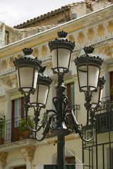Rod iron street lamps of Avila Spain, an old Castilian Spanish village