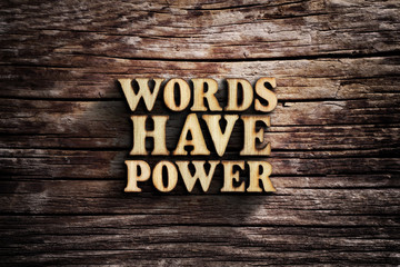 Words have power. Words on old wooden board.