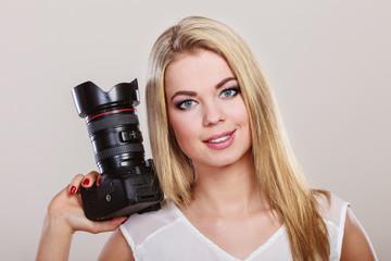 Beautiful woman with camera.