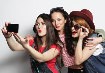 hipster girls best friends taking selfie