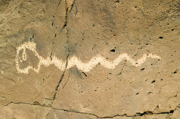 Native American petroglyphs featuring an image of a snake at Petroglyph National Monument, outside Albuquerque, New Mexico