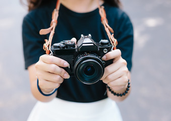 girl with vintage film camera