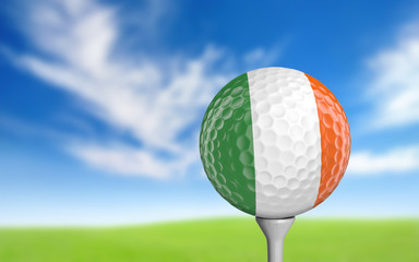 Golf ball with Ireland flag colors sitting on a tee