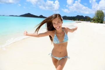 Wall Mural - Beach bikini woman happy running with aspiration, joyful, free and playful on Jolly Beach, Antigua Girl on travel vacation holidays having fun. Asian Chinese Caucasian female model.