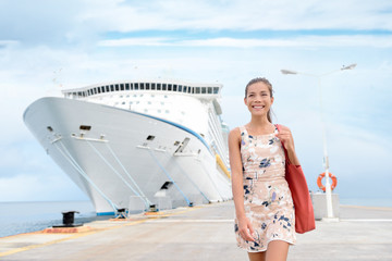 Wall Mural - Cruise ship travel going shopping in port on travel cruise vacation at sea. Happy mixed race Asian Chinese Caucasian woman in dress by luxury cruise liner boat.