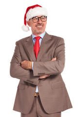 smiling old santa businessman standing with hands folded looks a