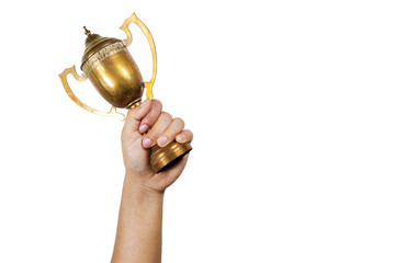 Holding the cup with white background.Conceptual of winning.