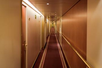 Narrow corridor with cabins