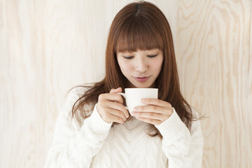Young women are drinking hot drinks