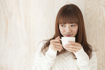 Young women are drinking hot coffee
