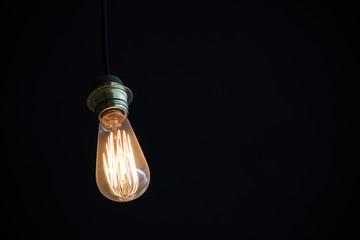 light bulb shines in the dark
