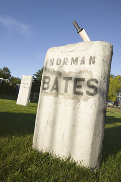 "Halloween knife is stuck in grave of ""Norman Bates"" from the Alfred Hitchcock film, ""Psycho,"" Newport, Rhode Island"