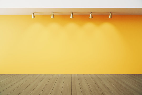 Empty room with yellow wall with lapms and wood floor
