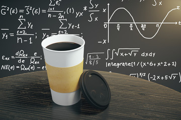 White cup of coffee on dark brown table with equation background