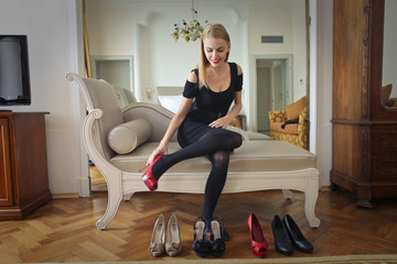 Girl trying different high heeled shoes