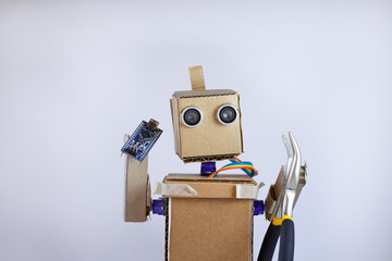robot arms, and a printed circuit board