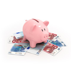 Pink piggy bank on euro bills isolated on white bacground