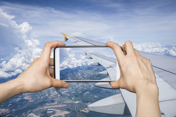 Girl taking pictures on mobile smart phone in Image plane of the
