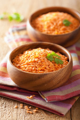 raw healthy red lentils in bowl