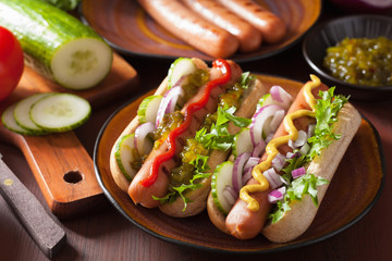 cooking grilled hot dogs with vegetables ketchup mustard