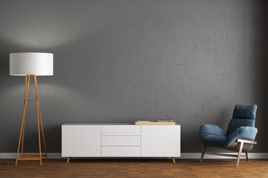 Sessel, Sideboard und Stehlampe vor grauer Wand