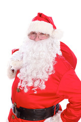 Kind Santa Claus carrying big bag, isolated on white background