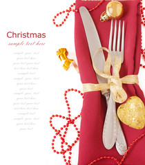 Christmas table place setting with christmas decorations isolated on white background with sample text