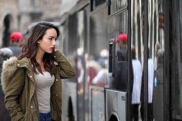 Beautiful girl at the bus stop