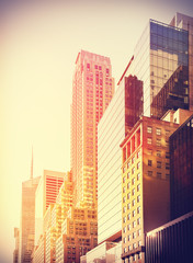 Vintage filtered photo of skyscrapers in at sunset, Manhattan, NYC.