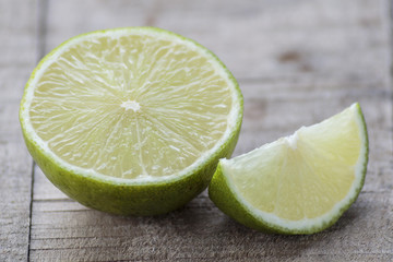 Fresh lime wedge on a wooden board