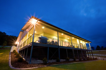 Exterior of lit contemporary house at dusk