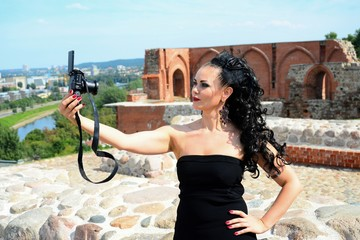 Beautiful girl make selfie in Vilnius town on Gediminas castle hill