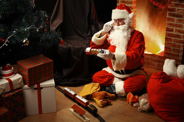 Portrait of happy Santa Claus sitting at his room at home