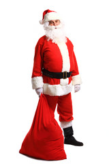 Full length portrait of a Santa Claus posing near a bag