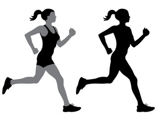 A female jogger in silhouette profile