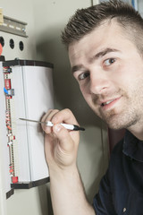 Portrait of an electrician in a room