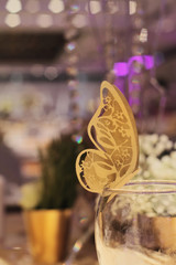 Paper Butterfly decoration. Golden autumn wedding table decoration.Table, Wine Glass, Mark. Fall Wedding Table Decor. New Year's Eve Wedding. Glamorous Event, celebration, Party in Gold