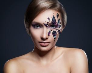 Fashion portrait of beautiful woman with art professional make