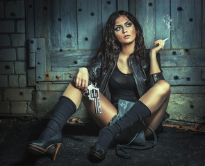 Brutal Girl with big gun, smoking.