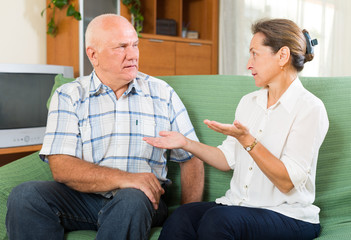 mature couple talking in home interior