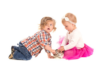 little boy and girl playing with alarm clock