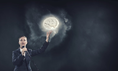 Woman speaker. Concept image