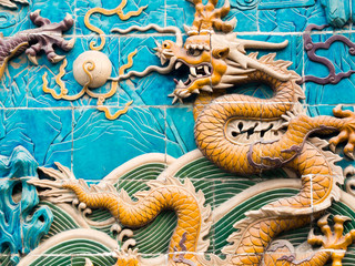 Chinese dragon on the Nine-Dragon Wall in Beihai park, Beijing