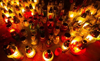 Candle flames illuminating cemetery during All Saint's Day