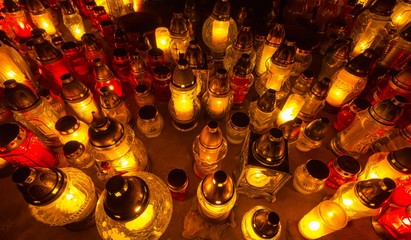 Bunch of glass candles in the cemetery