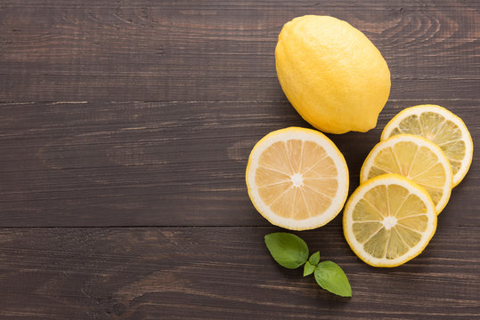 Fresh slice lemon on the wooden background