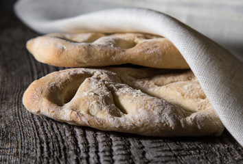Fresh homemade bread on light grey table. Selective focus. Shall