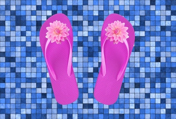 pink beach shoes with flowers on blue pool tile