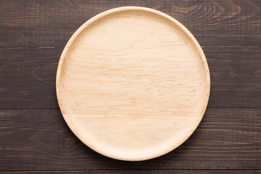 Wood dish on the wooden background. Top view