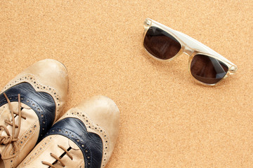Hipster's shoes and sunglasses